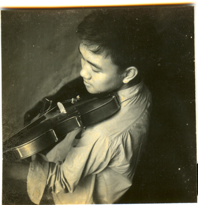 (Violin-playing, around age 15)