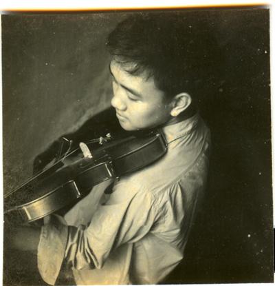 (Violin-playing, around age 15)