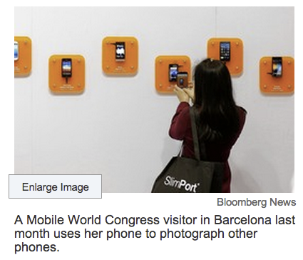 "new-aesthetic :     ""A Mobile World Congress visitor in Barcelona last month uses her phone to photograph other phones.""    Twitpic - Share photos and videos on Twitter"