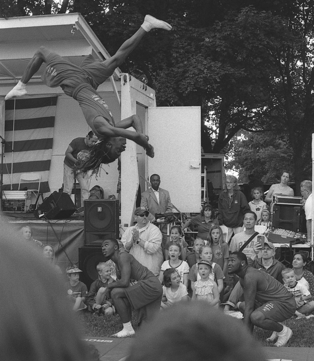 A member of the Jesse White Tumbling team performs at the July 3rd Wilmette Independence Day festival (July 3rd, 2017)
