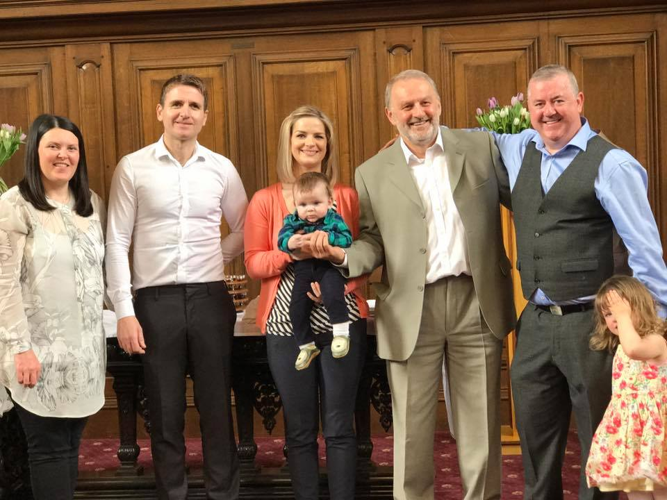 Samuel with his big sister, parents and Godparents