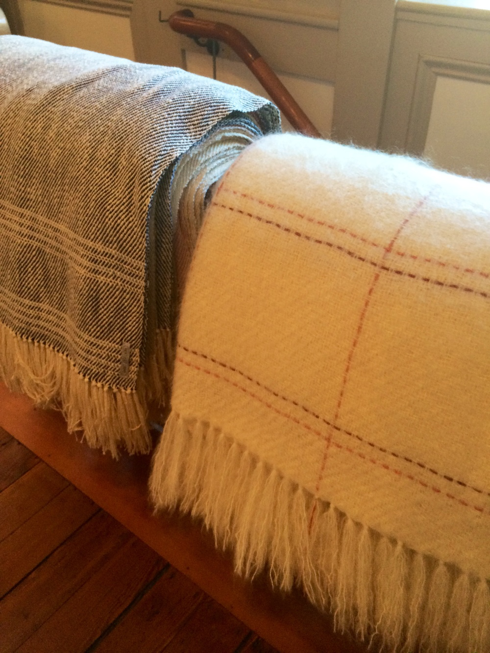Freshly woven throws made right upstairs.