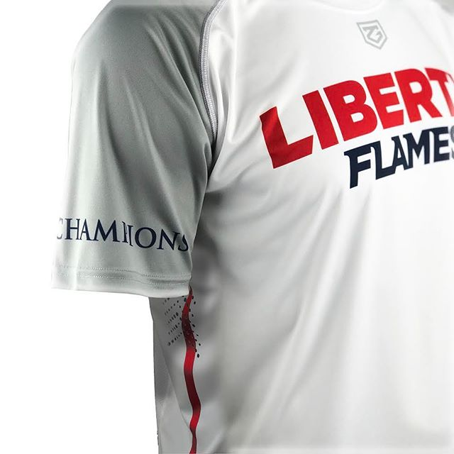 The 2018 Liberty Men's Lacrosse Shooters also feature Laser-Cut ventilated side panels & the University's Declaration of Faith, We the Champions, on the right sleeve.  #zimagear #libertylax #libertyflames #mcla