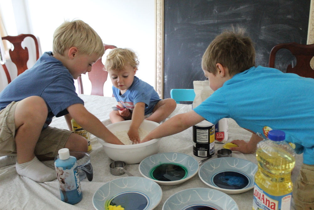 Teamwork on mixing the dry ingredients.
