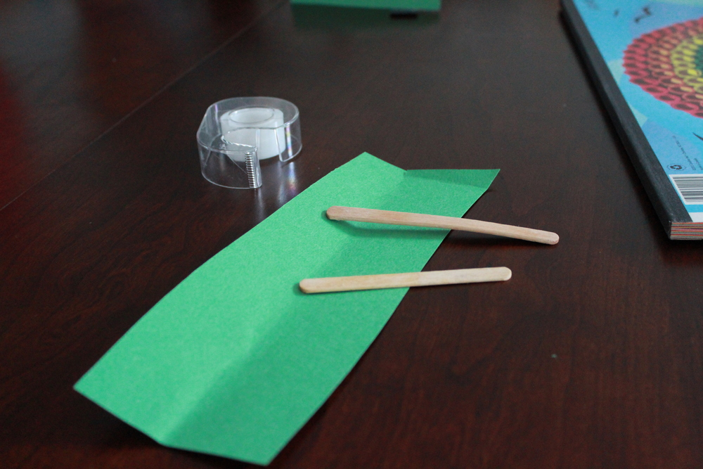 Supplies:  Tape, popsicle sticks, construction paper.