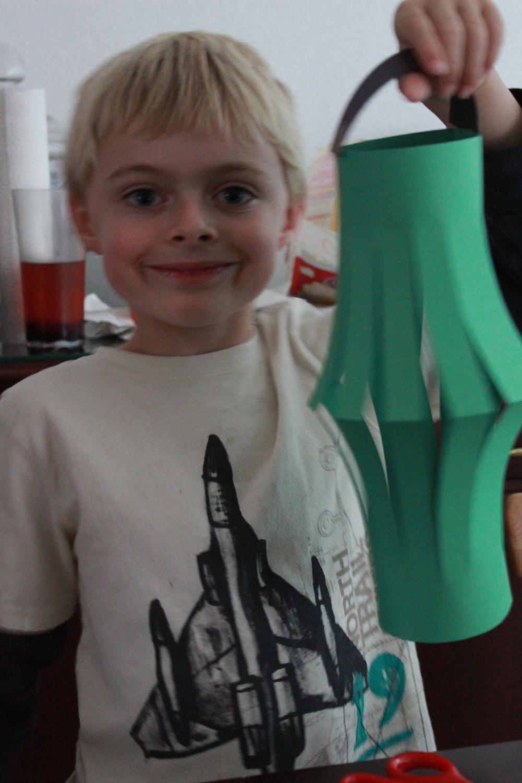 Proudly displaying his lantern.