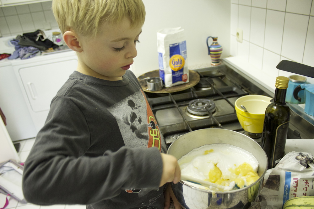 Mixing the whites and yolk mixtures.