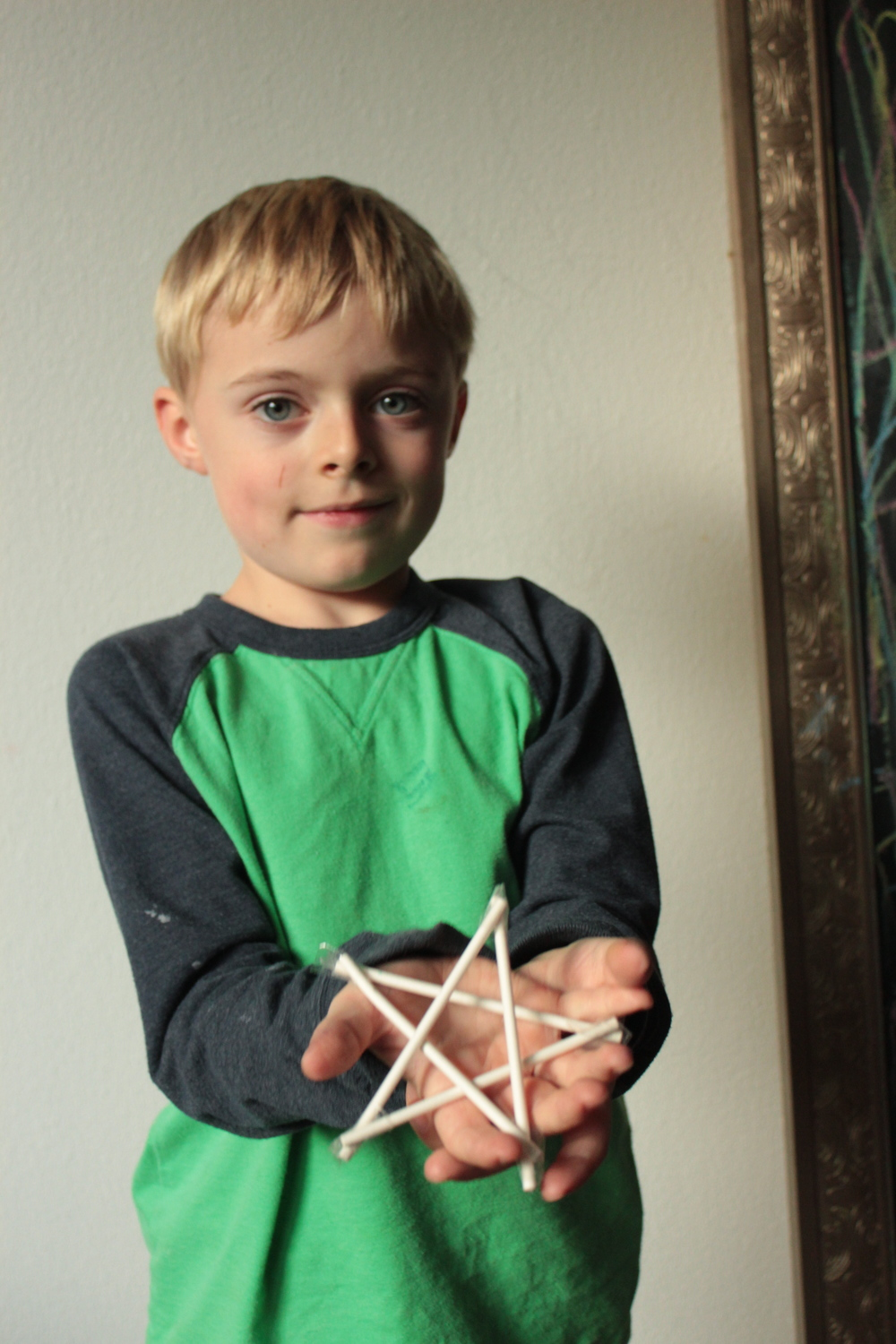 Sticks taped into star shape.
