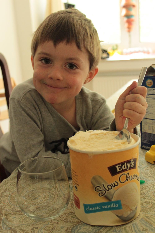 Scooping some vanilla ice cream.