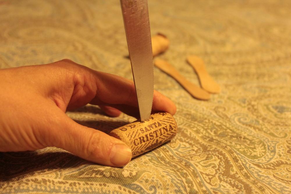Carefully cutting the cork