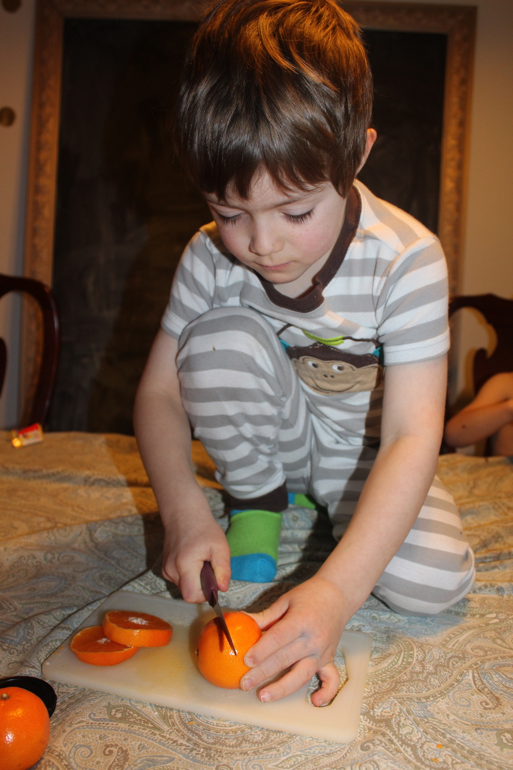Embaressing that I allowed him to cut this way- but here you go-slicing the oranges