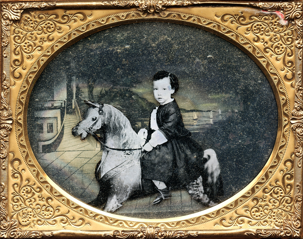 Portrait of a Child on His Rocking Horse