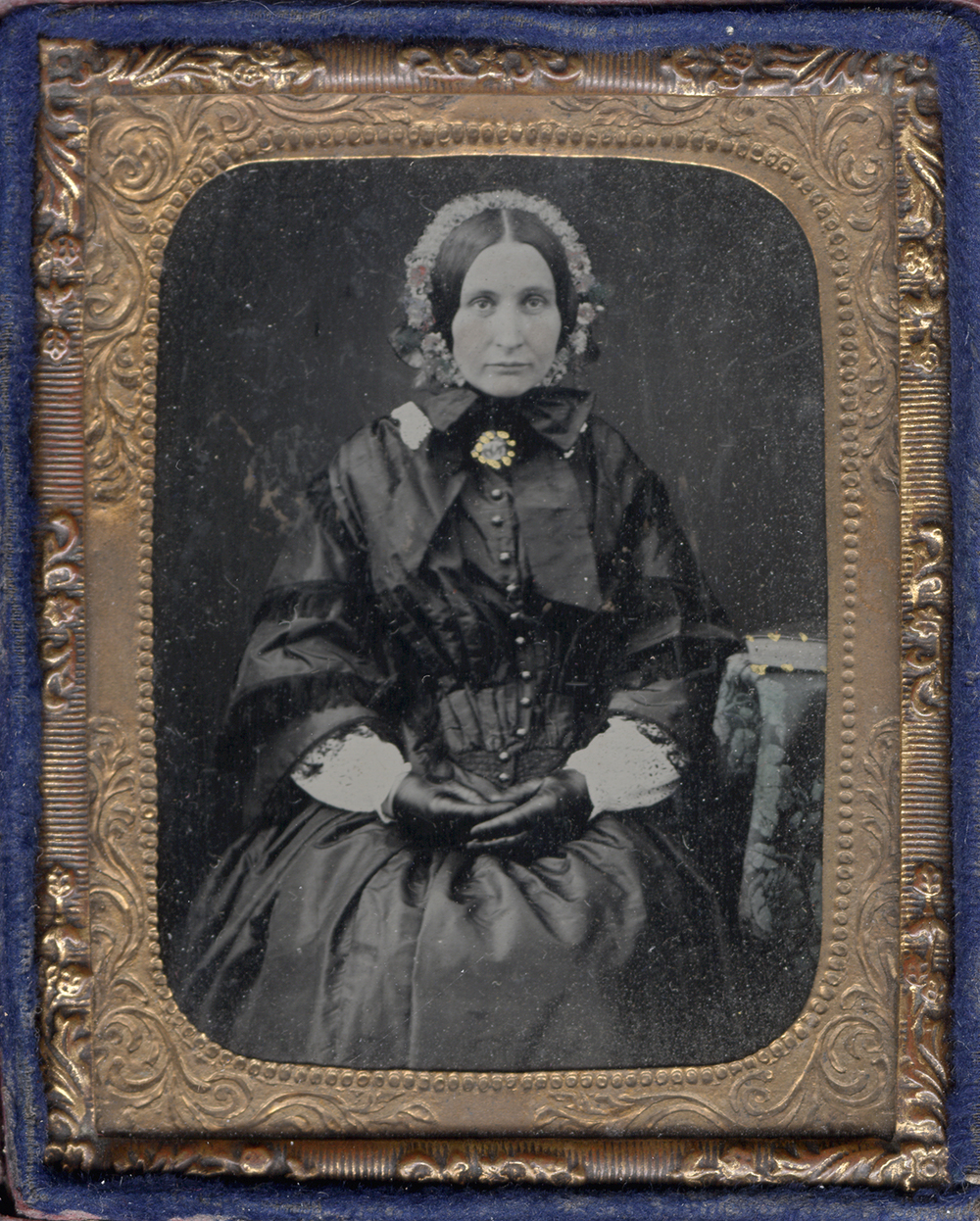 Portrait of a Seated Woman Wearing Leather Gloves