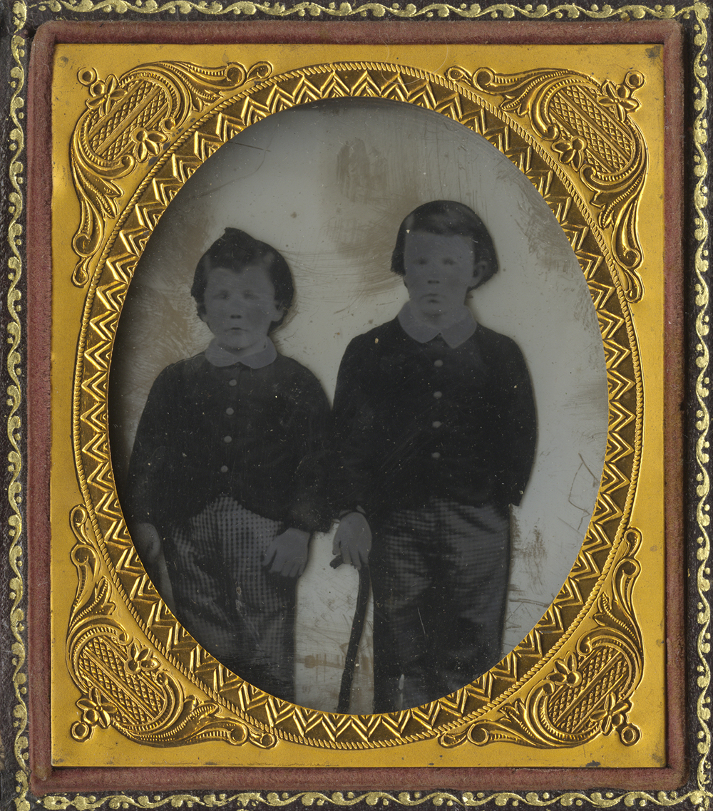 Portrait of Two Young Boys in Matching Outfits