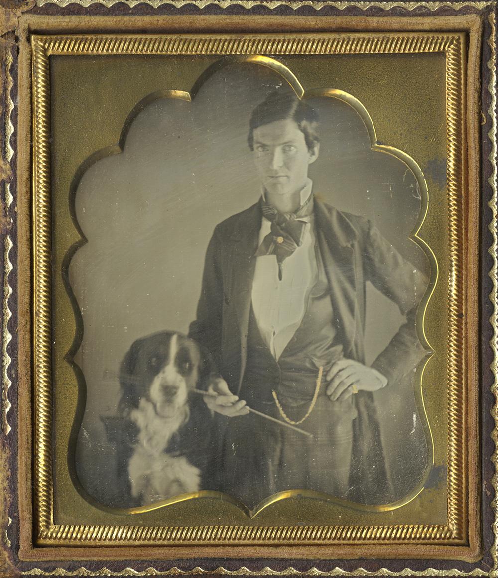 Portrait of a Gentleman Standing Beside His Dog