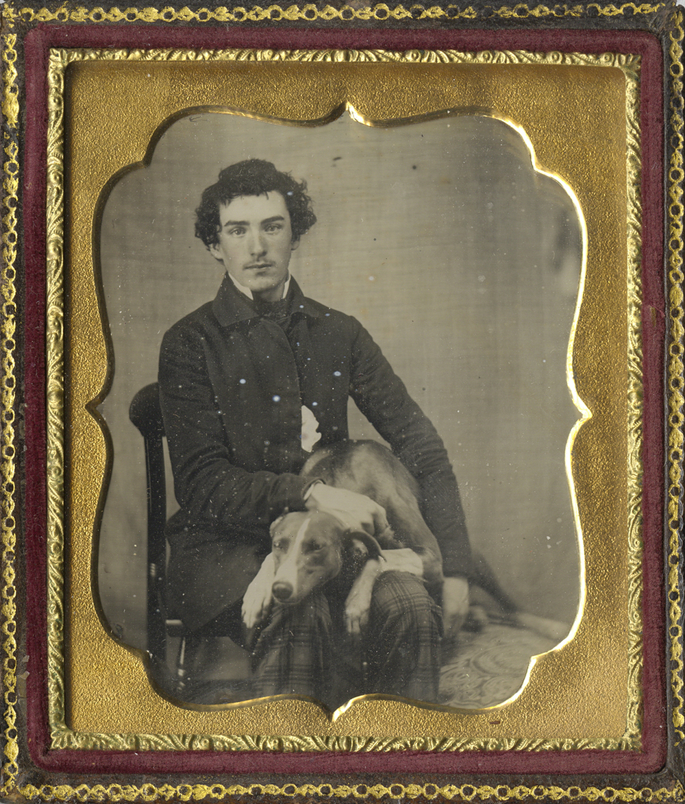 Portrait of a Young Man Seated with Dog on his Lap