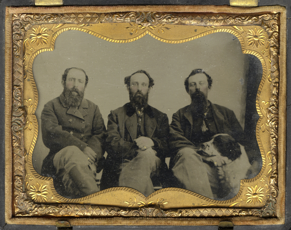 Three Men and Seated in a Row, with a Dog