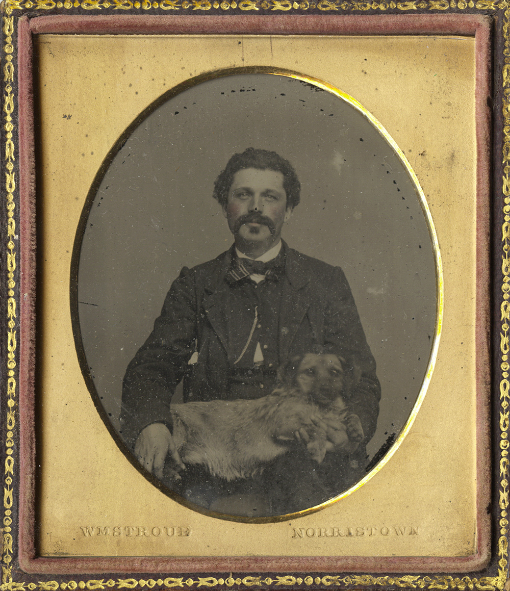 Portrait of a Man Seated with a Pekinese in His Lap