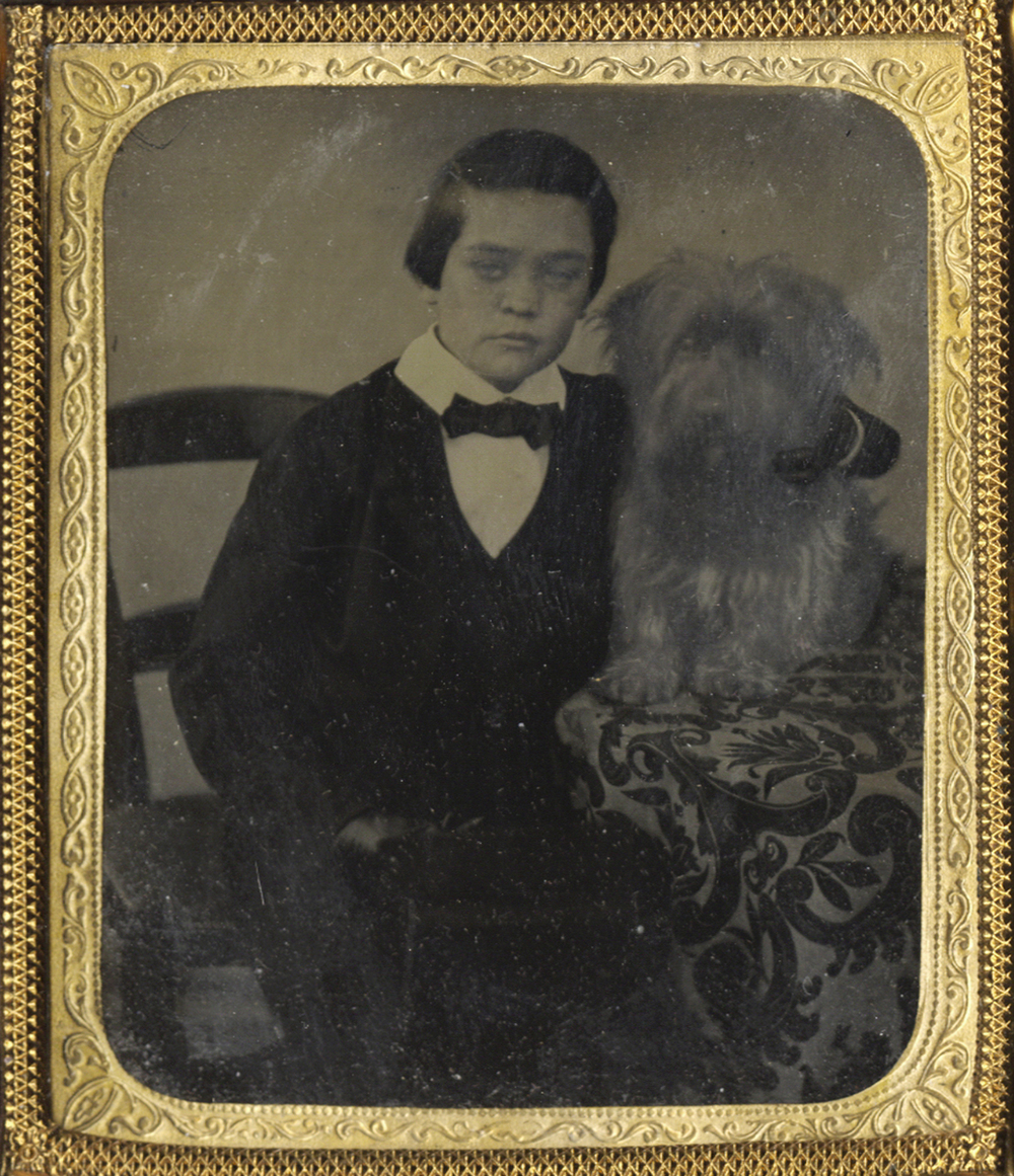 Portrait of a Boy Seated with His Arm Around his Cairn Terrier
