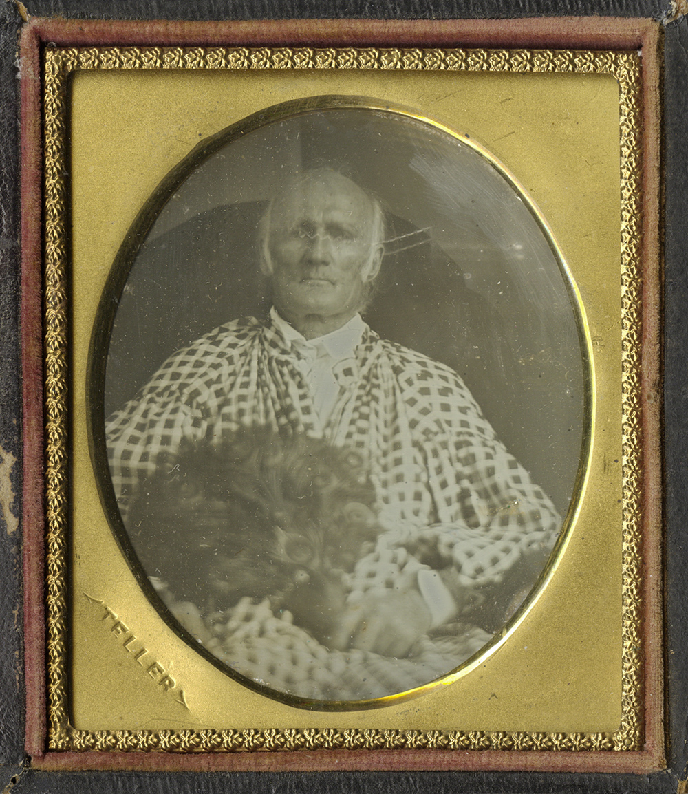 Portrait of a Man Holding a Dog on his Lap