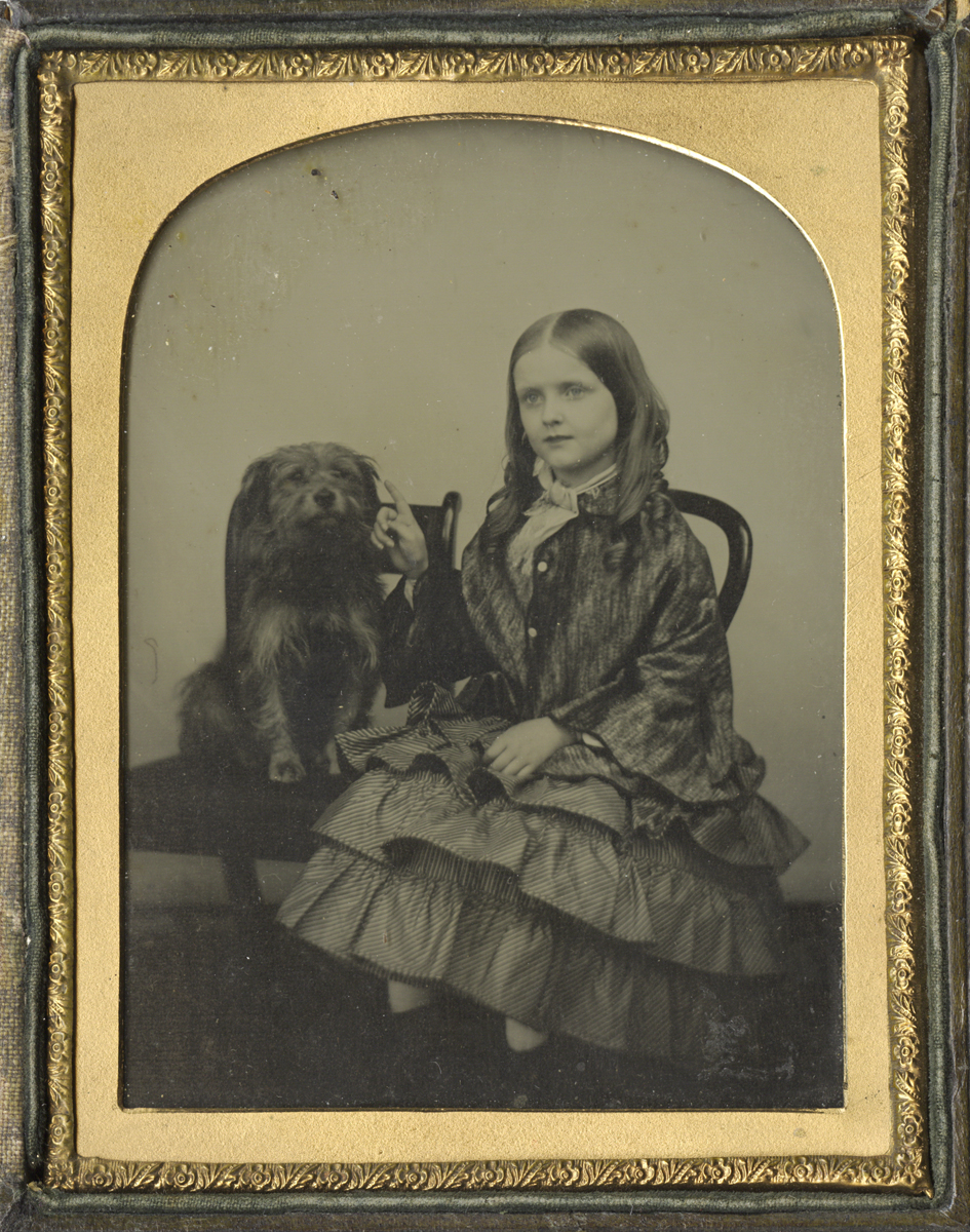 Portrait of a Girl and her Dog Seated Side by Side