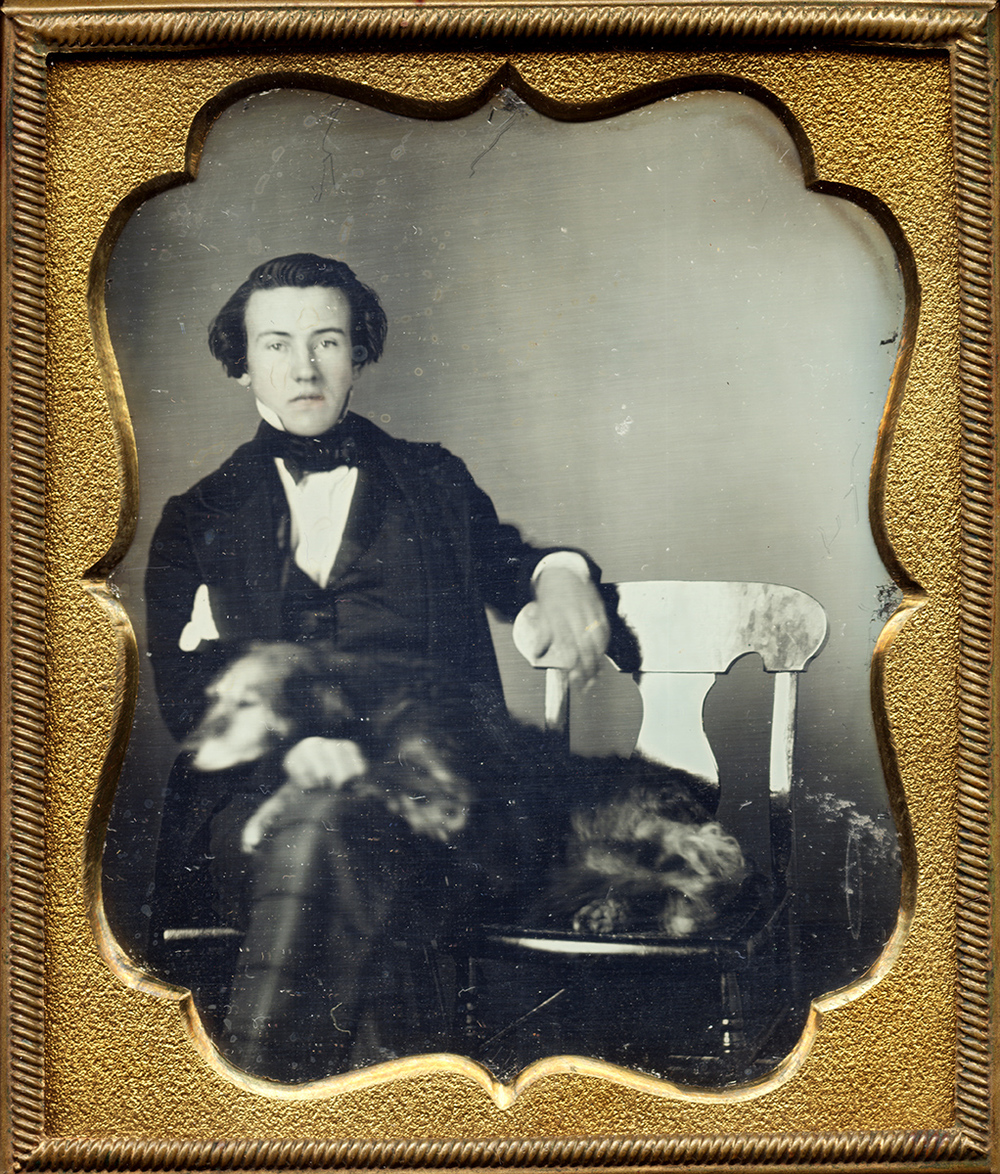 Portrait of a Seated Young Man with his Dog Next to him, Leaning on the Man's Lap
