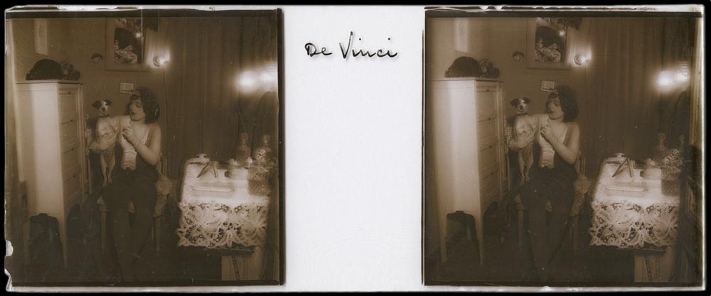 Portrait of a Woman Holding De Vinci the Dog