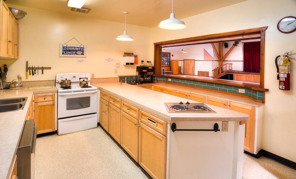Kitchen       The kitchen is located at the back side of the Main Hall. The kitchen comes fully equipped with an electric stove, commercial dishwasher, fridge, all dishes / cooking utensils and has ample counter prep space.