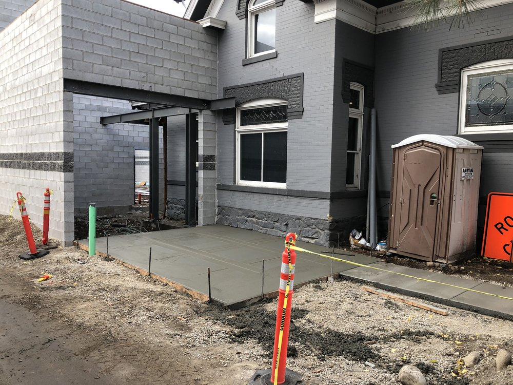 This patio in front of the new lobby will get a pergola overhead and a tall fence to enclose the area. The current plan is to get rid of the outhouse but I'm open to suggestions.