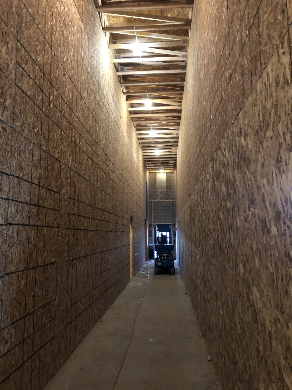Today they sheeted most of the hallway between studios making it look massive.