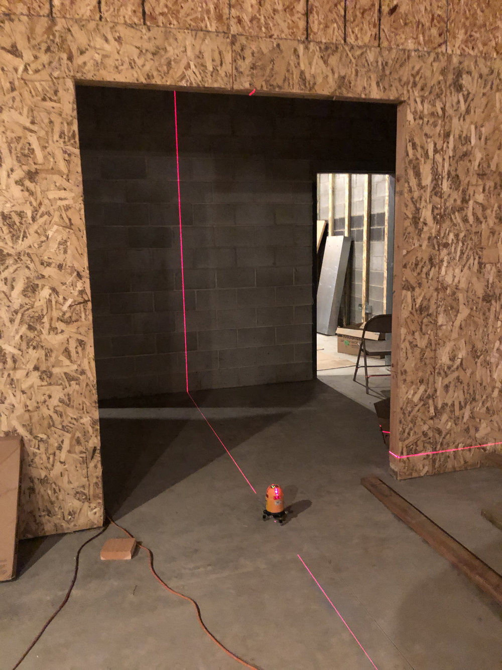 Using the laser to set the center line in studio 2 and start laying out the walls for the isolation booth.