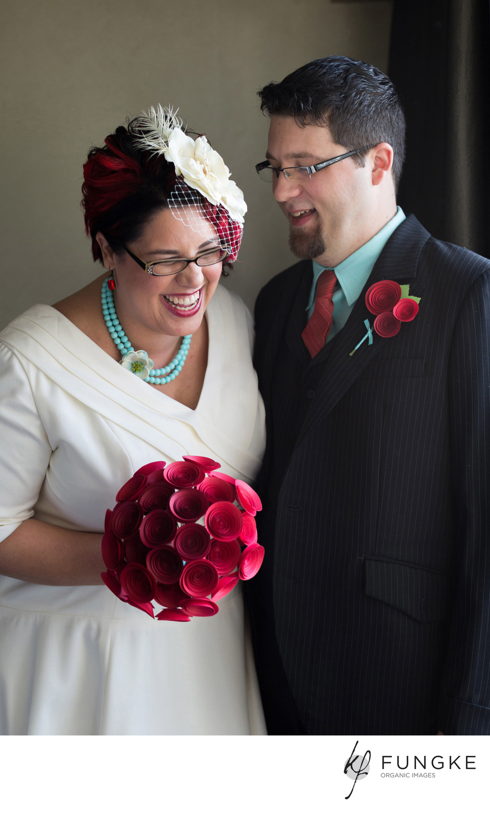 Angela is carrying a stunning large paper flower bouquet in red ombre.   ©2013  Fungke  Images    http://www. fungke .com/