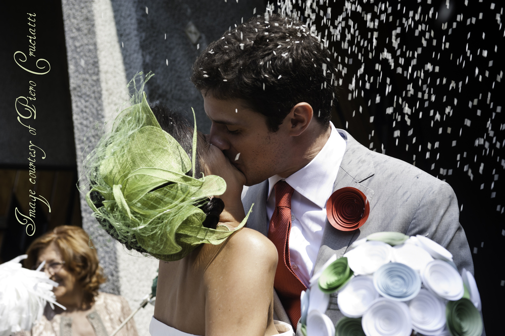 Angela and her new husband celebrate with a kiss outside the church.  Image courtesy of Piero Cruciatti.