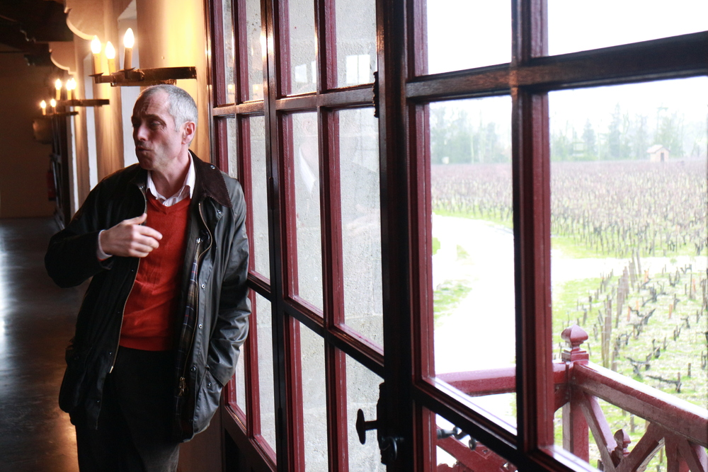 Jean Michel Comme holding court in full view of the vineyards of Pontet Canet.