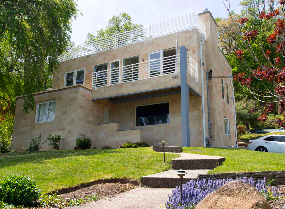 A modern twist to an existing mundane brick cape built in 1949, proved to be both a structural and architectural challenge.
