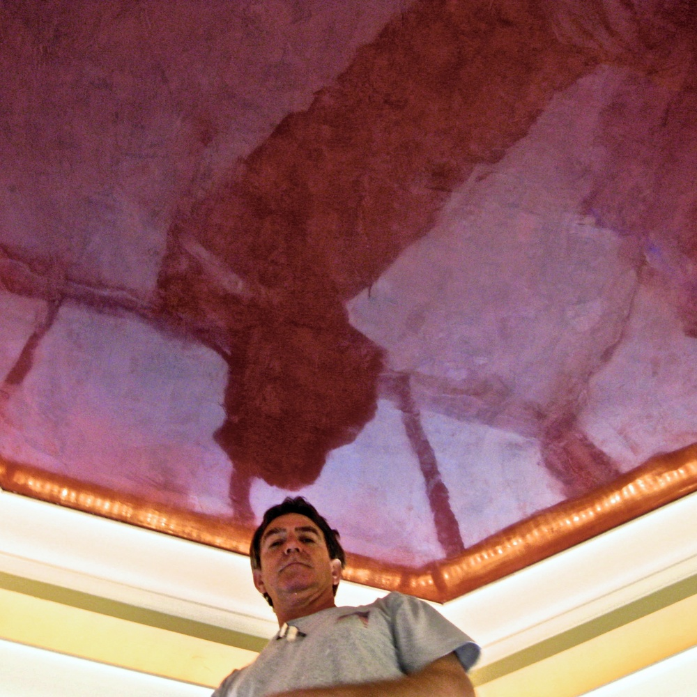 Jonathan Pettus at work on high polished Venetian Plaster at private residence.