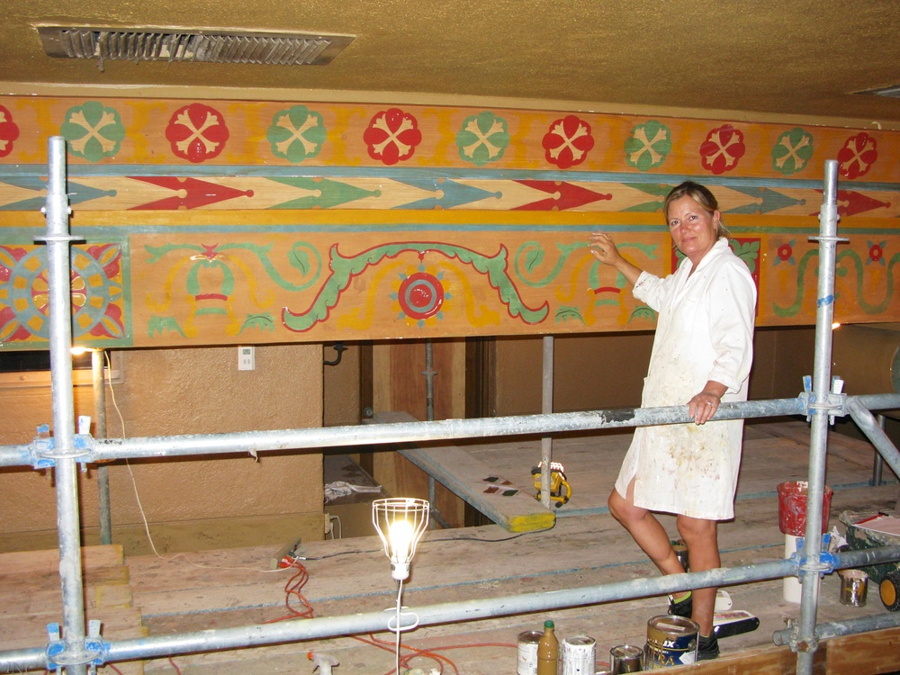 Alene Pettus restoring the decorative paint at the Annie Russell Theatre at Rollins College.
