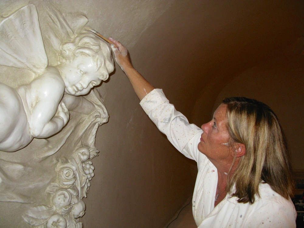 Alene Pettus restoring the decorative paint at The John and Mable Ringling Museum of Art.