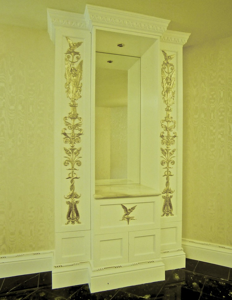Detail-of-cabinetry-in-white-for-a-card-room-in-the-neo-classic-style-with-24k-gold-accents.jpg
