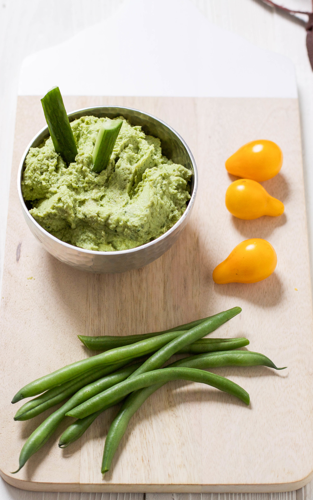This zesty avocado and edamame dip requires just four ingredients, and is fast and easy to make! You'll love it because it's healthy and delicious, and your toddler will love it because they can dip and feed themselves. This is a terrific finger food to get more veggies into your picky eater, or to offer in a packed lunch or afternoon snack. #dip #snacks
