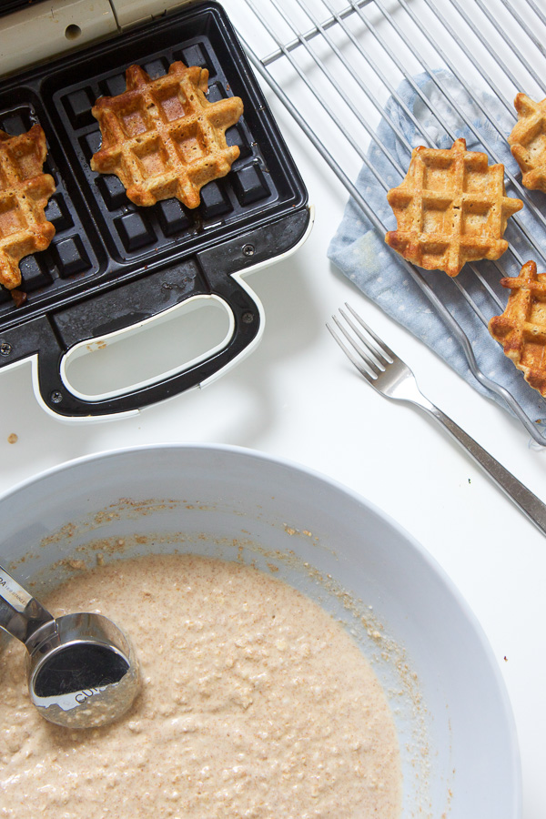 These mini sweet potato waffles are perfect for baby's first finger foods - easy to grasp, easy to gnaw on and easy for you to enjoy right along with them! They're a delicious and healthy breakfast, snack, and also great for school lunches! #waffes #babyledweaning