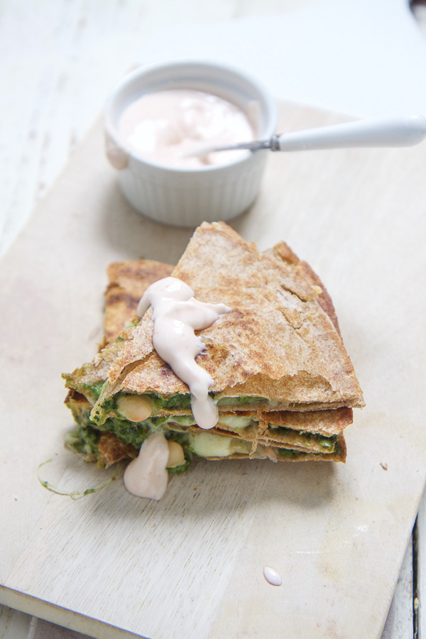 A filling and healthy version of your standard quesadilla - filled with a kale, spinach and apples and loaded with beans and cheese for a complete meal that most toddlers and kids (and parents) can't resist - even your picky eater!! Perfect for school lunch, or a quick and easy weeknight dinner. This is easy healthy kids food at its most delicious! #pickyeaters #kidapproved