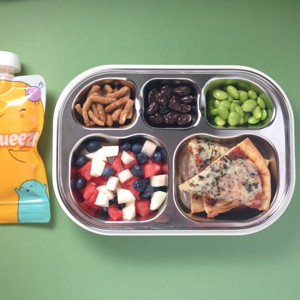 Whole wheat pita pizza with basil, nectarine + blueberry + watermelon finger salad, sesame sticks, dark chocolate covered raisins, frozen edamame with a reusable pouch filled with pumpkin + apple + yogurt puree.