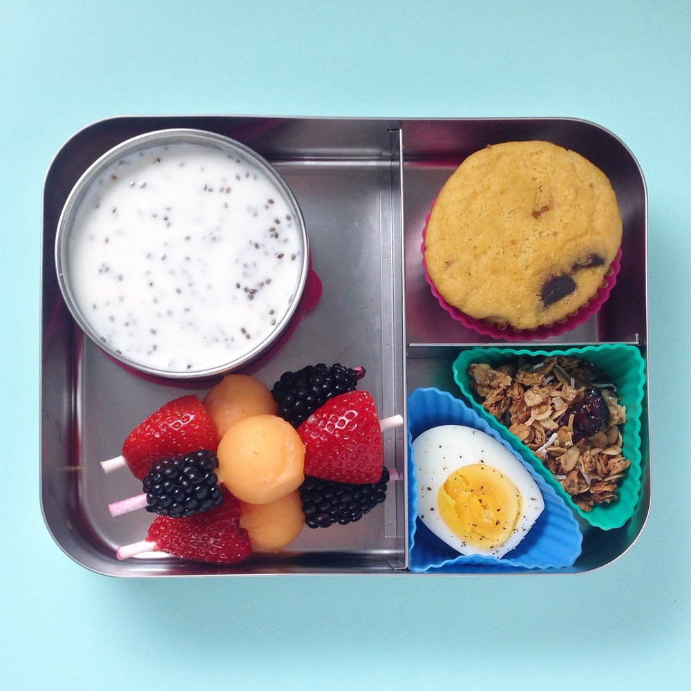 Breakfast for Lunch - fruit kabob (strawberry, melon and blackberry), yogurt with chia seeds, grain-free refined-sugar free dark chocolate chip muffin, homemade granola and hard boiled egg.