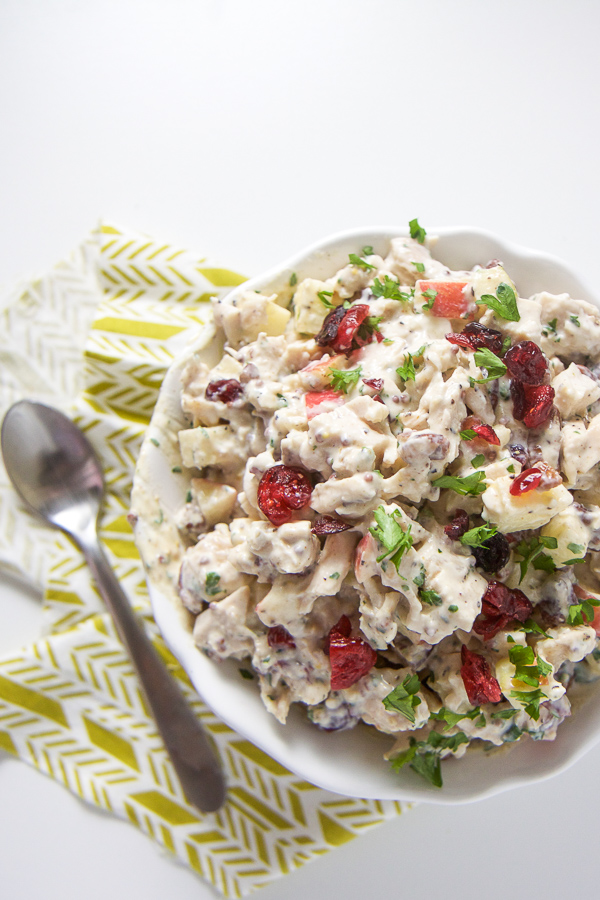 This healthy Harvest Chicken Salad is full of cubed chicken, apples, pecans and dried cranberries, all tossed with a yogurt and mustard dressing. This no mayo chicken salad is easy for you to make and easy for your toddler or big kid (and you) to devour for lunch, dinner, or a picnic! It's also great for packed school lunch. #kidfriendly #chickensalad