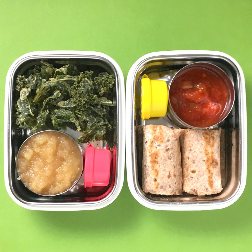 Bento box on left - kale chips, homemade applesauce, pink container has chocolate covered sesame seeds. Bento box on right - leftover slow cooker salsa chicken + cheese baked flautos, salsa, yellow container has a couple dried blueberries.