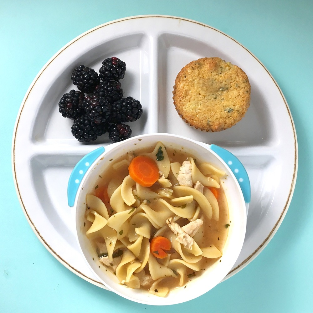 Homemade chicken noodle soup, blackberries and cilantro + cheddar + double corn bread muffin.