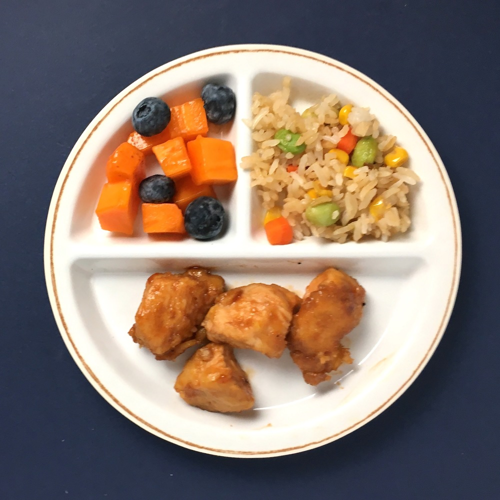 Cashew chicken, persimmon + blueberry finger salad and fried brown rice with veggies + edamame.