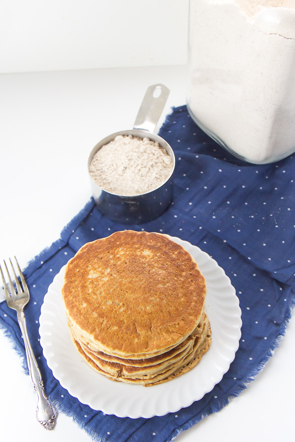 This easy Whole Wheat Pancake Mix takes 5 minutes to toss together and is made with whole wheat, ground flax seeds and just the right amount of cinnamon. It's the perfect staple to stock in your pantry for a quick breakfast on a busy morning! #pancakes #breakfast