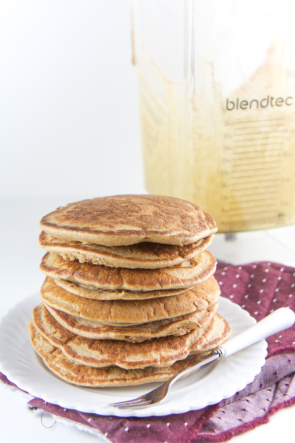 These spiced pancakes are gluten free, refined sugar free and dairy free and are filled instead with wholesome oats, one banana, a splash of almond milk and a big pinch of warming spices. The best part - they are 100% made in a blender and the prep time is under 4 minutes! These are a big hit with toddlers and kids for breakast (or anytime!). #pancakes #glutenfree